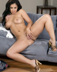 Sexy brunette siren, Aria Giovanni, is a busty vision stripping out of her tight white top, tight jean shorts, and suspenders and showing off her amaz
